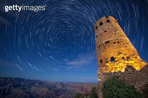 Scenic view with tower at southern rim of Grand Canyon under star trails at night, Arizona, USA - gettyimageskorea