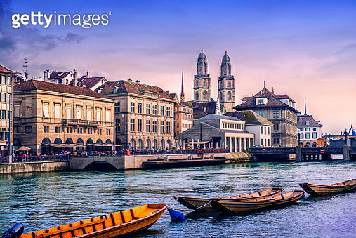 Grossmunster Cathedral with River Limmat in Zurich at Sunset - gettyimageskorea
