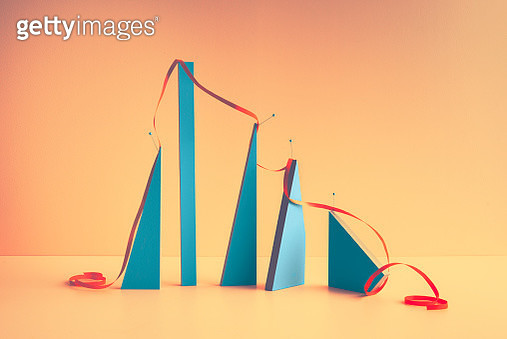 A ribbon covering blocks symbolizing a graph - gettyimageskorea