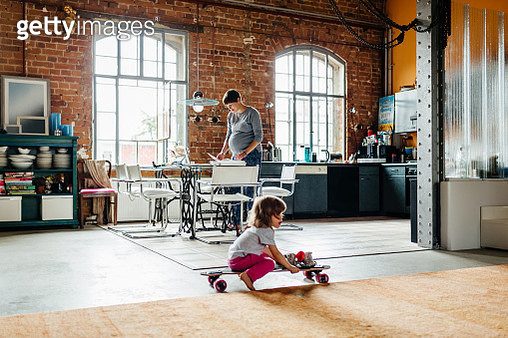 Young Girl Playing On Skateboard In Large Living Room - gettyimageskorea