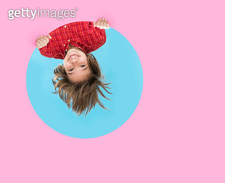 Upside down child through pink blue frame - gettyimageskorea