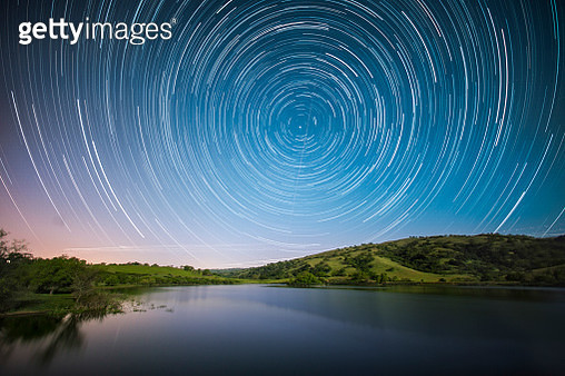 Beautiful scenery with star trails above lake at dusk, San Jose, California, USA - gettyimageskorea