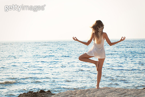 woman at sunset at the beach - gettyimageskorea