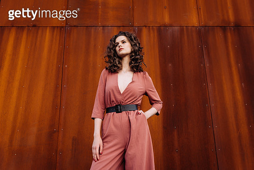Young and beautiful woman in casual clothes in the street. Autumn fashion concept. - gettyimageskorea