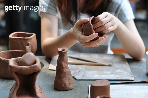 Midsection Of Woman Making Clay Pots At Table - gettyimageskorea