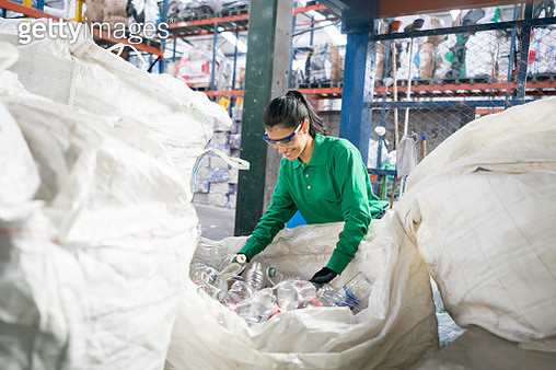 Woman working in a recycling factory - gettyimageskorea