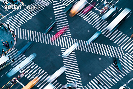 Blur motioin concept.Aerial view car move fast  on pedestrian crosswalk in modern city - gettyimageskorea