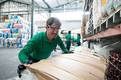 Man working in a recycling factory - gettyimageskorea