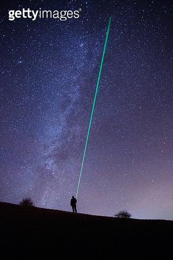 Explorer Pointing Laser Beam At Stars - Milky Way - gettyimageskorea