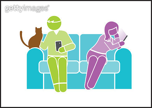 Heterosexual couple sitting on sofa with cat - gettyimageskorea