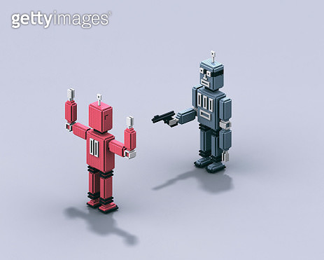 Robot threatening another one with a gun - gettyimageskorea