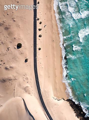 Aerial view of road near Ocean and Corralejo desert dunes, Fuerteventura - gettyimageskorea