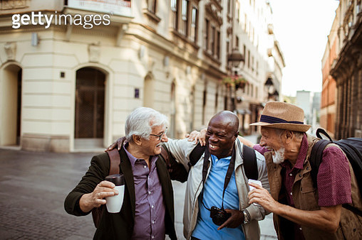 Close up of a group of male senior tourists exploring the city - gettyimageskorea