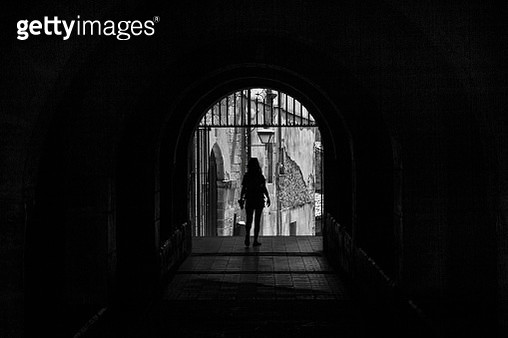 Rear View Of Silhouette Woman Walking In Archway - gettyimageskorea