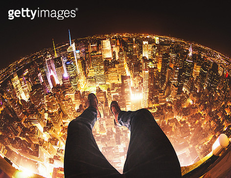 Relaxing in New York City on top of a building - gettyimageskorea