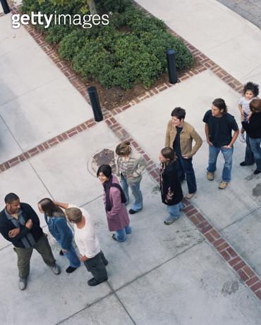 Group of people in line on sidewalk, elevated view - gettyimageskorea