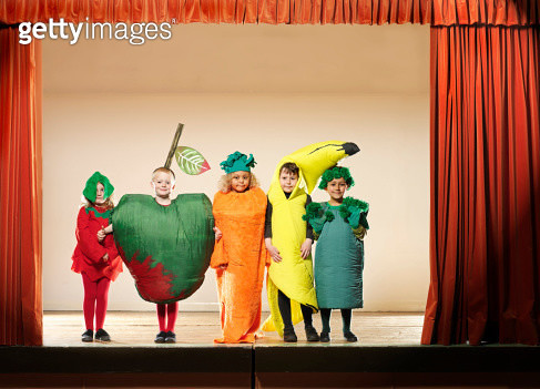 Children (4-6) on stage wearing fruit and vegetable costumes, portrait - gettyimageskorea