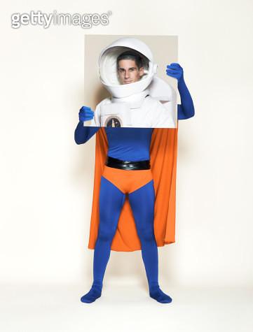 Superhero holding picture of astronaut - gettyimageskorea
