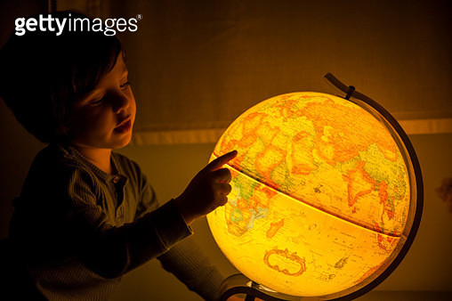 Young Boy playing With World Ball At Home - gettyimageskorea