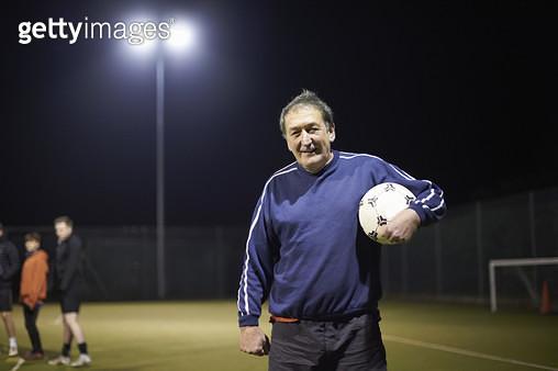 Senior man holding a soccer ball - gettyimageskorea
