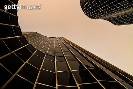 Round shaped skyscrapers architecture at dusk. - gettyimageskorea