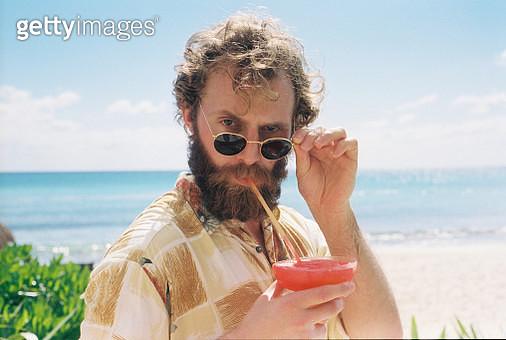 Portrait Of Man Drinking Cocktail - gettyimageskorea