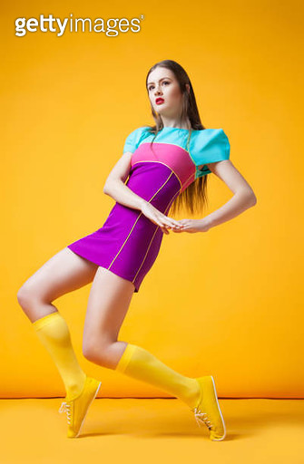 Pretty woman in colorful dress - gettyimageskorea