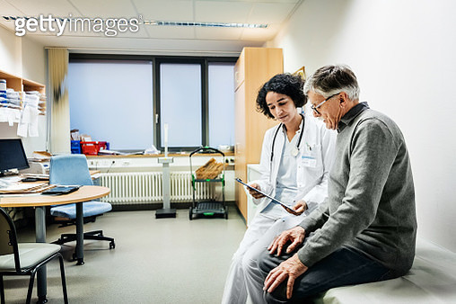 Elderly Man Talking To Doctor About Test Results - gettyimageskorea