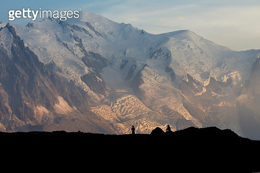 Campers silhouette and their tent in front of the Mont Blanc range during sunset - gettyimageskorea