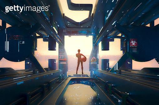 Futuristic astronaut looking over cityscape - gettyimageskorea