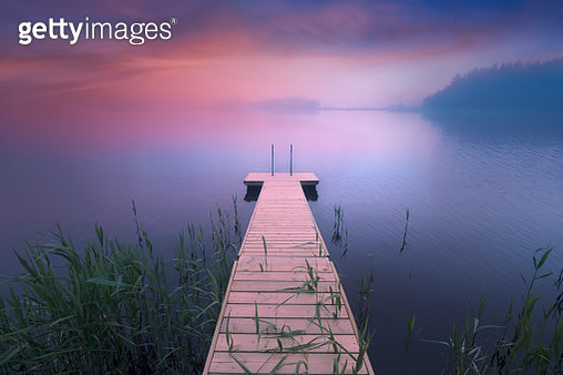 Wooden pier. Midsummer lake at evening in Finland - gettyimageskorea