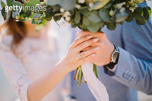 Midsection Of Bride And Groom Holding Bouquet - gettyimageskorea