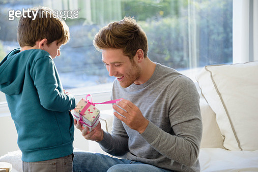 Happy father and son with birthday gift - gettyimageskorea