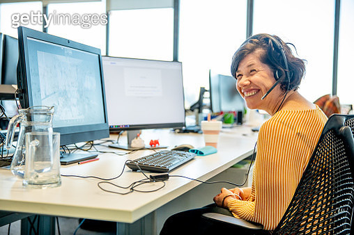 Four women working in an office together, holding meetings, having discussions, conferencing in person and using  technology. - gettyimageskorea