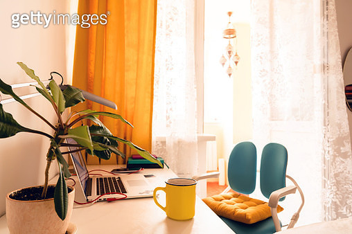 A cozy workplace at home, a laptop, a diary of 2020, a yellow cup of coffee, a mobile phone on a charge - gettyimageskorea