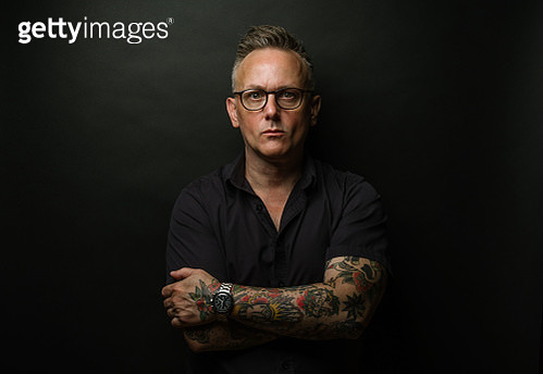 Middle-aged man with tattoos - gettyimageskorea