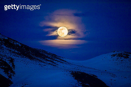 Full moon over mountains at night in Bellevue, Idaho, USA - gettyimageskorea