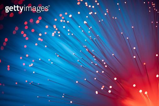 Red Color Illuminated Fiber Optics Selective Focus on Blue Background. - gettyimageskorea
