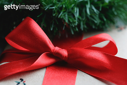 Close-Up Of Christmas Present With Red Ribbon - gettyimageskorea