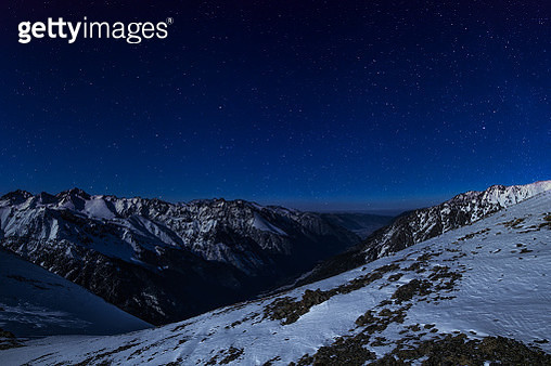 Majestic snowy mountain at night - gettyimageskorea