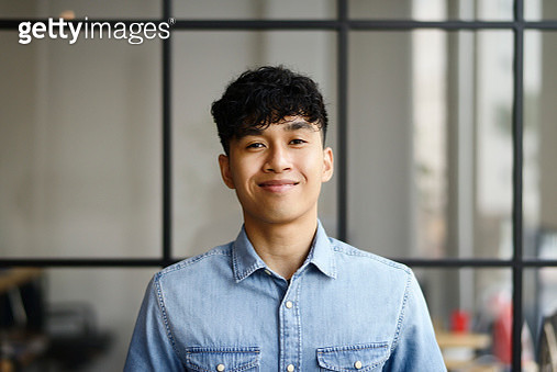 Portrait of a young Malay man in a modern office - gettyimageskorea