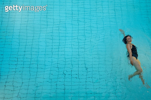 Woman Swimming in Pool, Directly Above in Switzerland. - gettyimageskorea