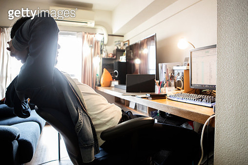 A man working from home leisurely - gettyimageskorea