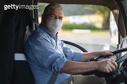 Portrait of a truck driver wearing a facemask to avoid the coronavirus - gettyimageskorea