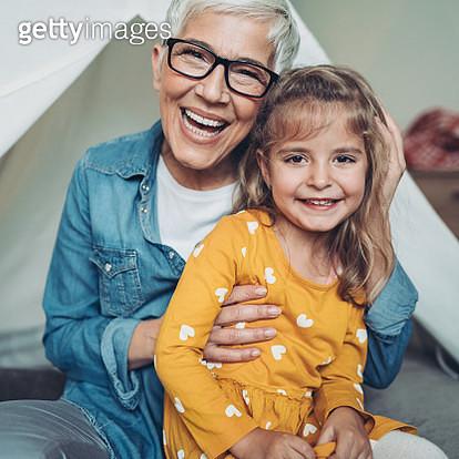 Senior woman embracing a little girl - gettyimageskorea