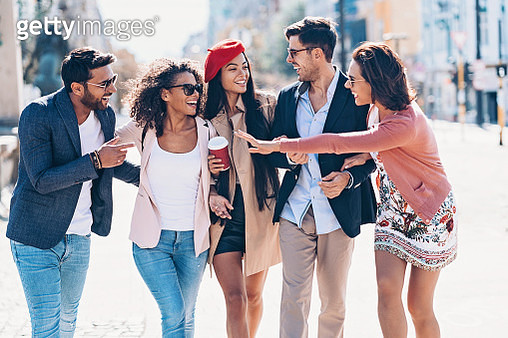 Multi-ethnic group of friends having fun together outdoors in the city - gettyimageskorea