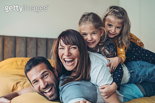 Family with two girls playing at home - gettyimageskorea