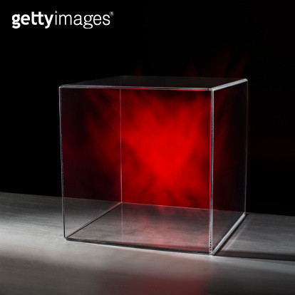 Red mist contained within a clear box on table on black background - gettyimageskorea