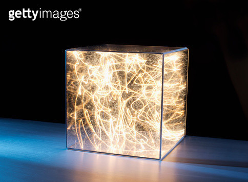 Trails of bright light and sparks trapped in clear box - gettyimageskorea