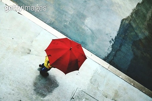 High Angle View Of Person Holding Umbrella - gettyimageskorea